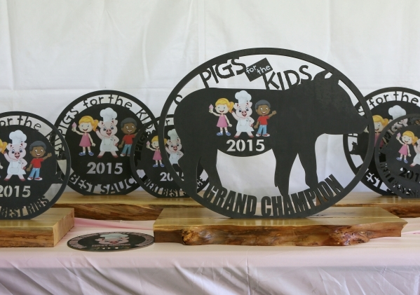 Trophies are shown in the barbecue judging tent at the Pigs for Kids Barbecue Cook-Off and Festival at Craig Ranch Regional Park Saturday, Sept. 19, 2015, in North Las Vegas. Ronda Churchill/Las V ...