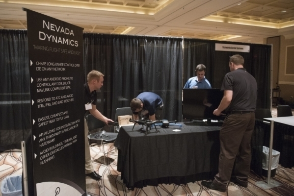 Workers for Nevada Dynamics, a Reno-based start-up, set up their display at InterDrone in the convention center at the Rio on Sept. 9. More than 3,000 people attended the show, which organizers wi ...