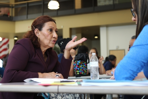 Maria Polanco, left, is assisted with her paperwork by her daughter and volunteer Fanny Garcia during a citizenship workshop hosted by local progressive groups, labor groups and immigration attorn ...
