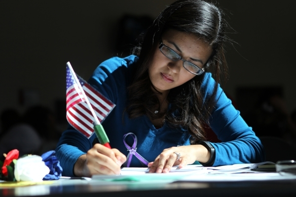 Volunteer Laura Baldovinos helps to fill out paperwork during a citizenship workshop hosted by local progressive groups, labor groups and immigration attorneys inside the June Whitley Student Cent ...