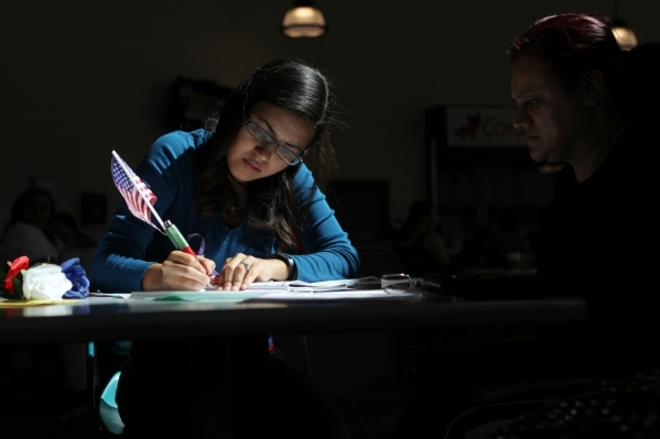 Volunteer Laura Baldovinos, left, helps Araceli Medina fill out her paperwork during a citizenship workshop hosted by local progressive groups, labor groups and immigration attorneys inside the Ju ...