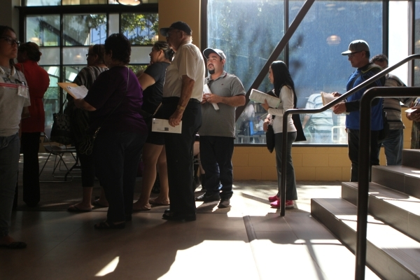 People wait in line during a citizenship workshop hosted by local progressive groups, labor groups and immigration attorneys inside the June Whitley Student Center at the College of Southern Nevad ...
