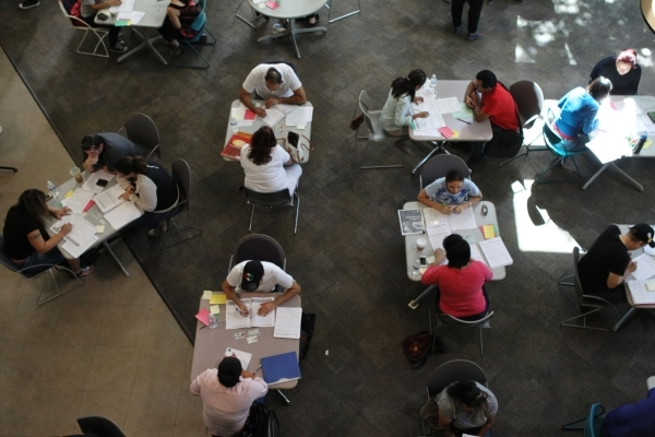 People participate in a citizenship workshop hosted by local progressive groups, labor groups and immigration attorneys inside the June Whitley Student Center at the College of Southern Nevada Che ...