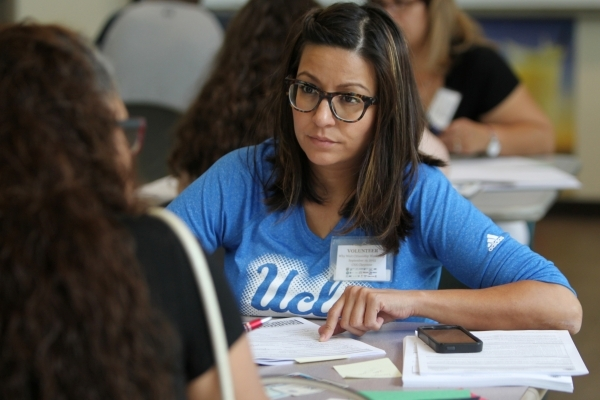 Fanny Garcia helps fill out paperwork during a citizenship workshop hosted by local progressive groups, labor groups and immigration attorneys inside the June Whitley Student Center at the College ...