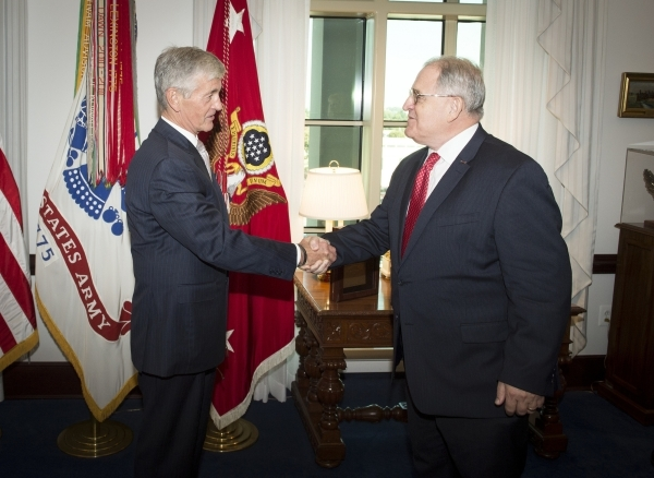 William T. Anton, right, receives congratulations from U.S. Army Secretary John McHugh at an investiture ceremony Sept. 8, 2015  at the Pentagon. Anton, of Las Vegas, was appointed a Civilian Aide ...