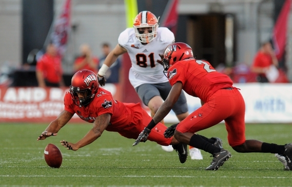 UNLV Rebels defensive back Peni Vea (42) recovers an Idaho State fumble in the first half at Sam Boyd Stadium on Saturday, Sept. 26, 2015. UNLV defeated Idaho State 80-8, setting a new school reco ...