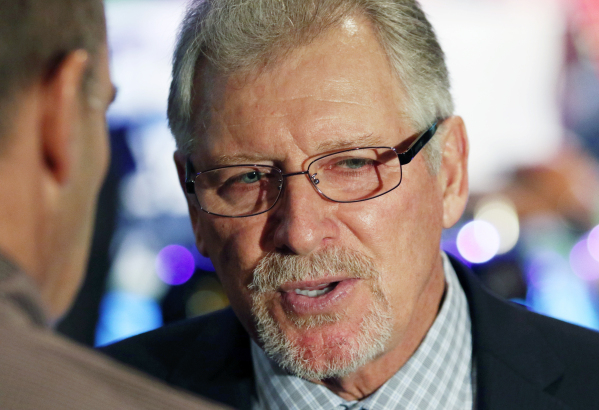 Former Oregon football coach and current ESPN college football analyst Mike Bellotti , right, speaks with news media during a Royal Purple Las Vegas Bowl ticket kickoff luncheon at the Hard Rock h ...