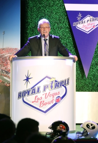 Former Oregon football coach and current ESPN college football analyst Mike Bellotti speaks during a Royal Purple Las Vegas Bowl ticket kickoff luncheon at the Hard Rock hotel-casino Wednesday, Se ...