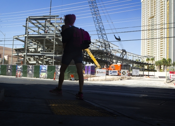 A woman walks near Topgolf Las Vegas at Koval Lane and Harmon Avenue just east of the Strip is seen on Wednesday, Sept. 23, 2015. The eight acre $50 million, four-level, 105,000-square-foot facili ...