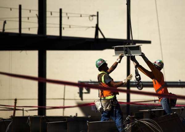 Workmen guide  beam at Topgolf Las Vegas at Koval Lane and Harmon Avenue just east of the Strip  on Wednesday, Sept. 23, 2015. The eight acre $50 million, four-level, 105,000-square-foot facility  ...