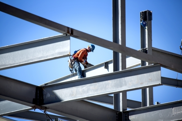 Workmen place a beam at Topgolf Las Vegas at Koval Lane and Harmon Avenue just east of the Strip  on Wednesday, Sept. 23, 2015. The eight acre $50 million, four-level, 105,000-square-foot facility ...