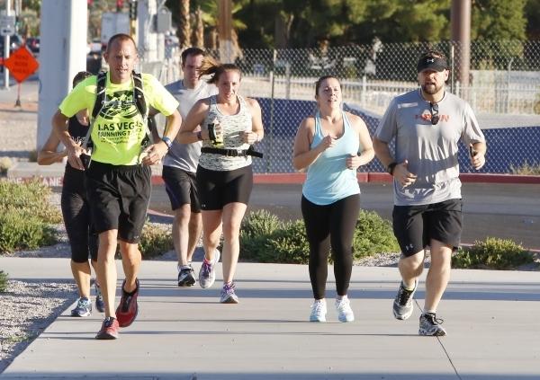 People take advantage of the cool early morning temperature to run on Las Vegas Boulevard near Town Square Wednesday, Sept. 23, 2015. (Bizuayehu Tesfaye/Las Vegas Review-Journal) Follow @BizuTesfaye
