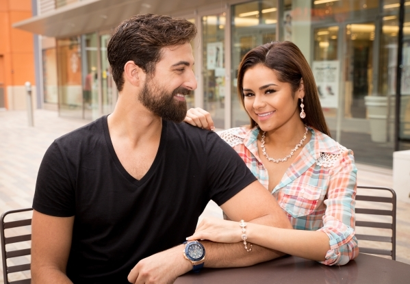 Model Aaron Alexander wearing Guess rose gold watch and model Janira Kremits wearing Givenchy rose gold earrings, necklace and bracelet at Downtown Summerlin. Photo Credit Tonya Harvey.