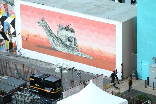 People walk by a mural as setup goes on at the Life is Beautiful festival, slated to take place Sept. 25-27, from The Ogden in downtown Las Vegas on Wednesday, Sept. 23, 2015. Chase Stevens/Las Ve ...