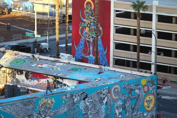 A man walks on a rooftop as setup goes on at the Life is Beautiful festival, slated to take place Sept. 25-27, from The Ogden in downtown Las Vegas on Wednesday, Sept. 23, 2015. Chase Stevens/Las  ...