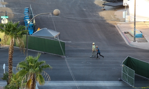 People skateboard as setup goes on at the Life is Beautiful festival, slated to take place Sept. 25-27, from The Ogden in downtown Las Vegas on Wednesday, Sept. 23, 2015. Chase Stevens/Las Vegas R ...