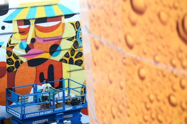"""Artist Ruben Sanchez observes his """"Fear and Loathing in Las Vegas"""" themed mural along the wall of Inspire at Las Vegas Boulevard and Fremont Street in Las Vegas on Wednesday, Sept. 23, 2 ..."""