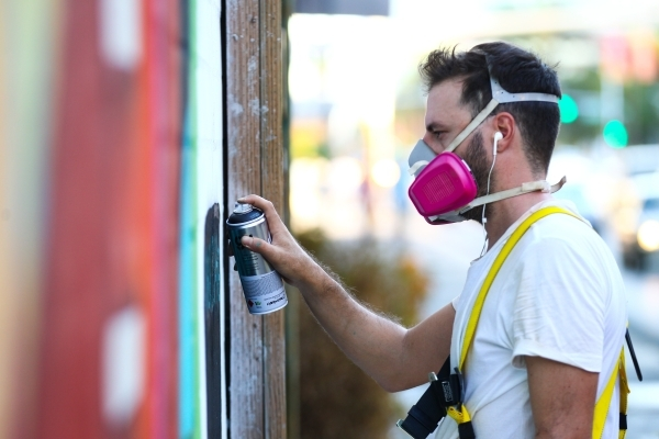 """Artist Ruben Sanchez puts on the final touches to a """"Fear and Loathing in Las Vegas"""" themed mural along the wall of Inspire at Las Vegas Boulevard and Fremont Street in Las Vegas on Wedn ..."""