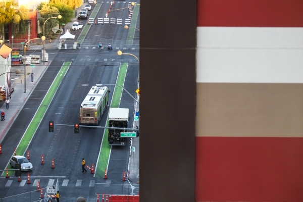 A bus heads east on Ogden Avenue as setup goes on nearby at the Life is Beautiful festival, slated to take place Sept. 25-27, from The Ogden in downtown Las Vegas on Wednesday, Sept. 23, 2015. Cha ...