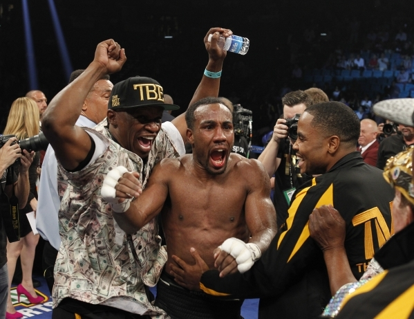 Mickey Bey celebrates after defeating Miguel Vazquez for the IBF lightweight title fight at the MGM Grand Garden Arena in Las Vegas on Saturday, Sept. 13, 2014. (Sam Morris/Las Vegas Review-Journal)