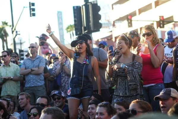 Attendees watch a performance by Absinthe during the Life is Beautiful festival in downtown Las Vegas on Saturday, Sept. 26, 2015. Chase Stevens/Las Vegas Review-Journal Follow @csstevensphoto