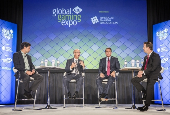 Executives Greg Carlin, from left, CEO of Rush Street Gaming, Gavin Isaacs, CEO of Scientific Games, Mark Frissora, president and CEO of Caesars Entertainment and moderater Bo Bernhard, executive  ...