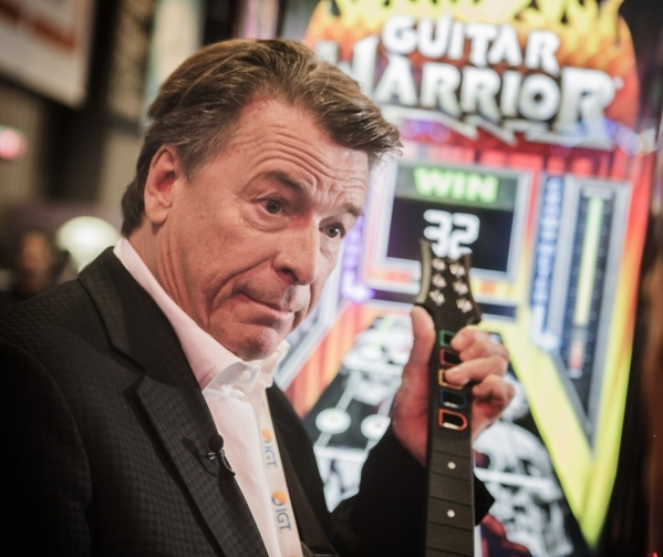 Gregg Giuffria, CEO of G2 Game Design, demonstrates Guitar Warrior skill-based gaming in the G2 booth at Global Gaming Expo in the Sands Expo and Convention Center on Wednesday, Sept. 30, 2015. Je ...