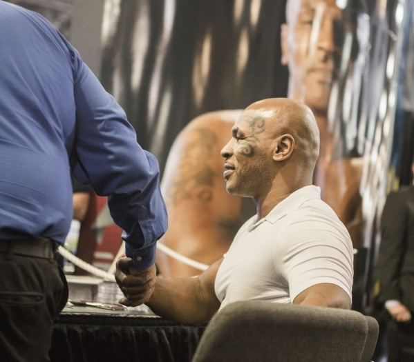 Former boxer Mike Tyson greets fans in the Inspired Gaming booth at the Global Gaming Expo in the Sands Expo and Convention Center on Wednesday, Sept. 30, 2015. Jeff Scheid/ Las Vegas Review-Journ ...