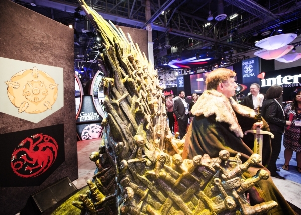 Jeff Taylor sits on a throne to promote Aristocrat's new Game of Thrones gaming machine at the Global Gaming Expo in the Sands Expo and Convention Center on Wednesday, Sept. 30, 2015. Jeff S ...