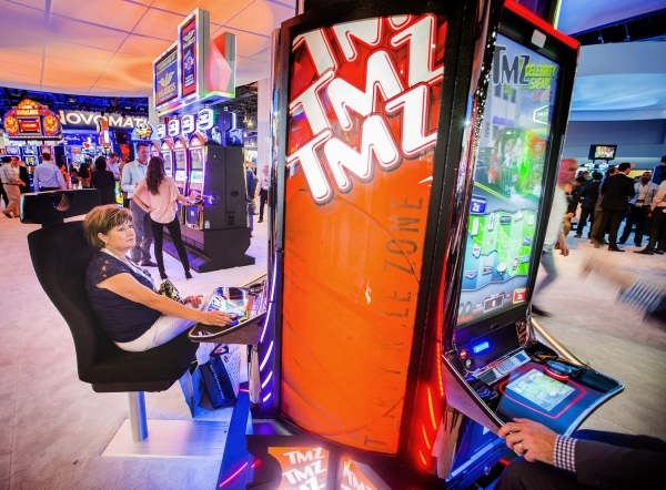 Cheryl Ludens play the new TMZ gaming machine in the International Game Technology booth at the Global Gaming Expo in the Sands Expo and Convention Center on Wednesday, Sept. 30, 2015. Jeff Scheid ...