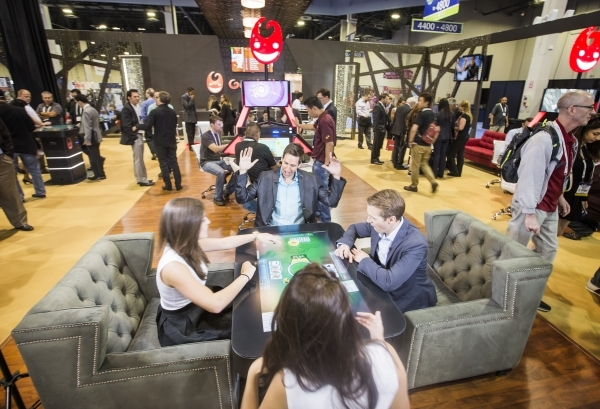 People play a tabletop skill-basef game in the Gamblit Gaming booth at the Global Gaming Expo in the Sands Expo and Convention Center on Wednesday, Sept. 30, 2015. Jeff Scheid/ Las Vegas Review-Jo ...