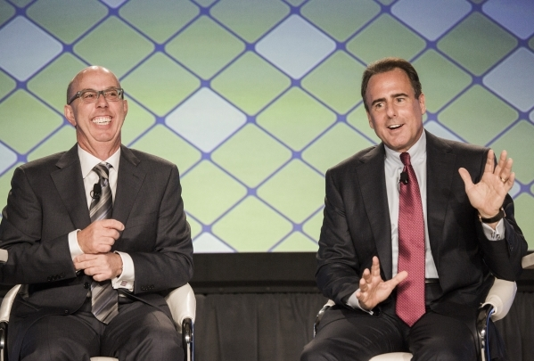 Mark Frissora, right, president and CEO of Caesars Entertainment, and  Gavin Isaacs, CEO of Scientific Games, are shown during a roundtable discussion at the Global Gaming Expo in the Sands Expo a ...