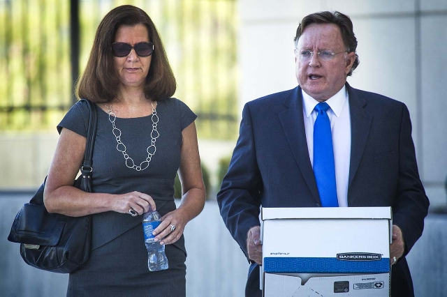 Ex-dancer Stephanie Markham, left, walks with  her attorney Robert Langford  arrives for court at Lloyd George U.S. Courthouse, 333 Las Vegas Boulevard, on Monday, Sept. 28,2015. (Jeff Scheid/Las  ...