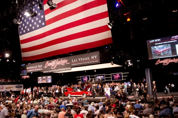 Spectators and bidders watch as cars are auctioned off during the Barrett-Jackson car auction inside the Mandalay Bay Convention Center on Saturday, Sept. 26, 2015. Daniel Clark/Las Vegas Review-J ...