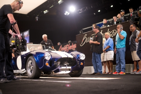 A 427 Shelby Cobra is rolled across the stage during the Barrett-Jackson car auction inside the Mandalay Bay Convention Center on Saturday, Sept. 26, 2015. Daniel Clark/Las Vegas Review-Journal