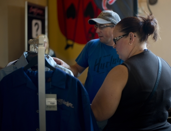 Peter Borse, left, and Stephanie Borse look at merchandise for sale during the Barrett-Jackson car auction inside the Mandalay Bay Convention Center on Saturday, Sept. 26, 2015. Daniel Clark/Las V ...