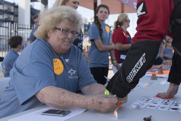 Michael Scardino, right, is registered to ride by volunteer Lucy Brickman during the Ride for Kids benefit at Las Vegas Motor Speedway in Las Vegas Sunday, Sept. 27, 2015. Jason Ogulnik/Las Vegas  ...