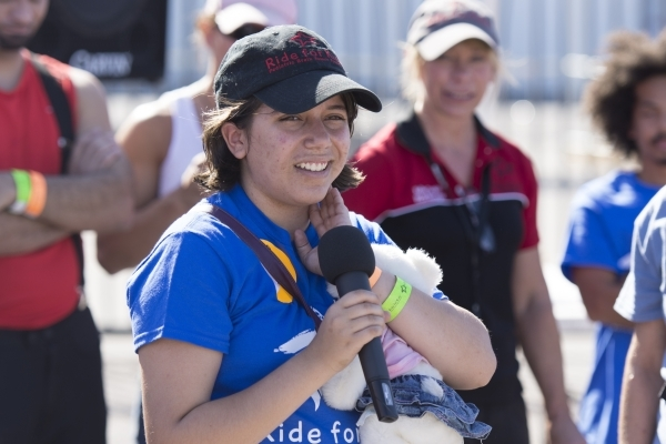 Thirteen-year-old brain cancer survivor Hannah Wilker speaks to ride participants at the Ride for Kids benefit at Las Vegas Motor Speedway in Las Vegas Sunday, Sept. 27, 2015. Jason Ogulnik/Las Ve ...