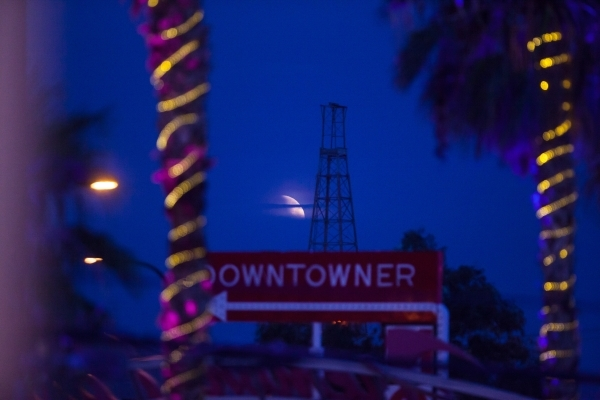 """The """"blood moon"""" peeks through the clouds during the Life is Beautiful festival in downtown Las Vegas on Sunday, Sept. 27, 2015. Chase Stevens/Las Vegas Review-Journal Follow @csstevensphoto"""
