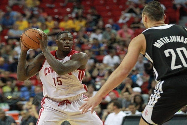 Cleveland's Anthony Bennett (15) looks to pass as Houston's Donatas Motiejunas (20) defends during an NBA Summer League game at the Thomas & Mack Center in Las Vegas on Thursday, J ...