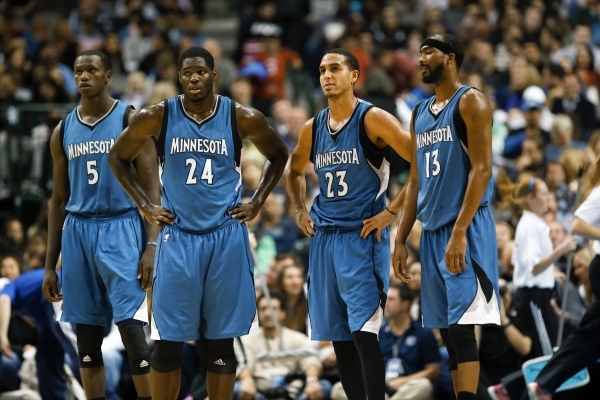 Nov 15, 2014; Dallas, TX, USA; Minnesota Timberwolves center Gorgui Dieng (5) and Minnesota forward Anthony Bennett (24) and  guard Kevin Martin (23) and  guard Corey Brewer (13) react during the  ...