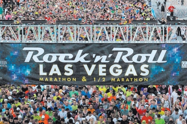 Runners cross the starting line for the Rock 'n' Roll Las Vegas Marathon and Half-Marathon on the Las Vegas Strip in 2013. The race weekend continues to gain popularity; last year&lsqu ...