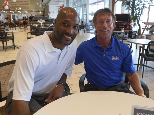 Courtesy photo   Former basketball great Ed O'Bannon, left, found a home with Findlay Toyota nearly ten years ago. He is shown with dealership General Manager Rich Abajian.