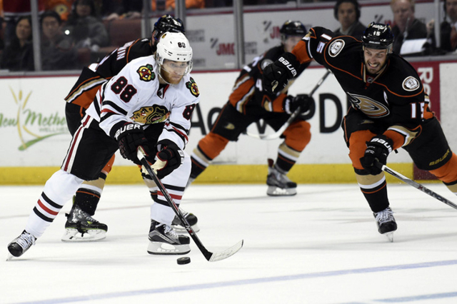 May 30, 2015; Anaheim, CA, USA; Chicago Blackhawks right wing Patrick Kane (88) controls the puck as Anaheim Ducks center Ryan Getzlaf (15) moves in to defend during the third period in game seven ...