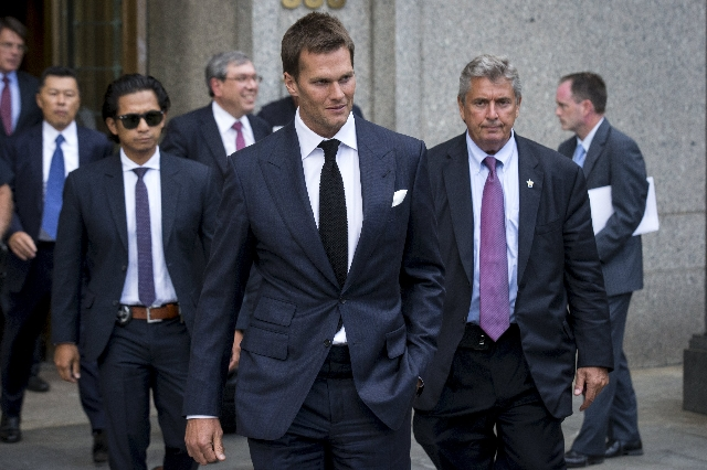 New England Patriots quarterback Tom Brady exits the Manhattan Federal Courthouse in New York August 12, 2015. A federal judge on Wednesday fired tough questions at a National Football League lawy ...