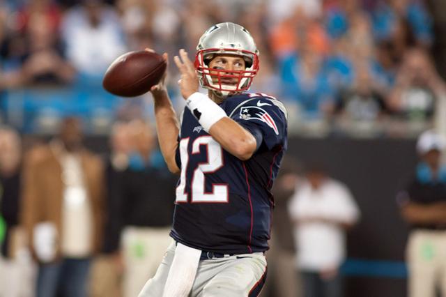 Aug 28, 2015; Charlotte, NC, USA; New England Patriots quarterback Tom Brady (12) passes the ball during the second quarter against the Carolina Panthers at Bank of America Stadium. (Jeremy Brevar ...