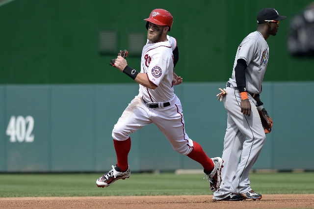 Aug 30, 2015; Washington, DC, USA;  Washington Nationals right fielder Bryce Harper (34) runs to third base during the fifth inning against the Miami Marlins at Nationals Park. (Tommy Gilligan/USA ...
