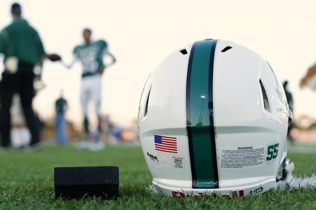 A football helmet's health warning sticker is pictured at a high school football team practice in Oceanside, California September 14, 2012. (Mike Blake/Reuters)