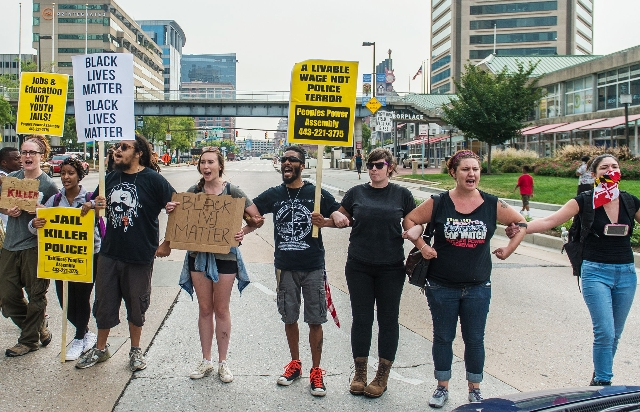 Protesters block traffic on Pratt Street as protests moved into the street on the first day of pretrial motions for six police officers charged in connection with the death of Freddie Gray in Balt ...