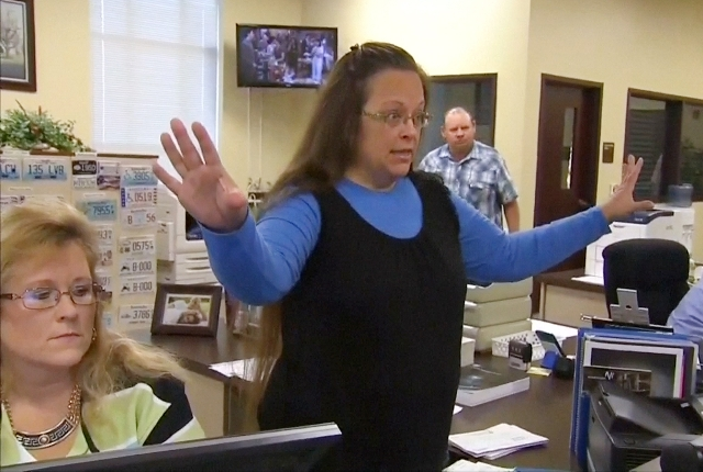 Rowan County Clerk Kim Davis gestures as she refuses to issue marriage licenses to a same-sex couple in Morehead, Kentucky, Sept. 1, 2015. (Still image from WLEX/LEX18.com/Reuters)